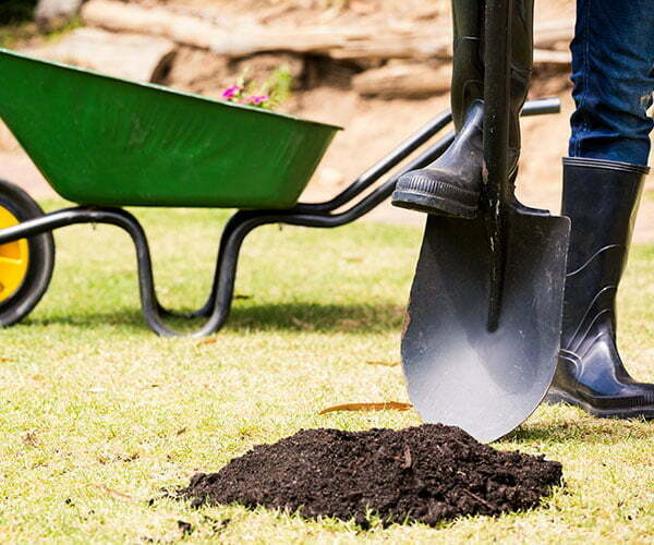 soil on grass with shovel