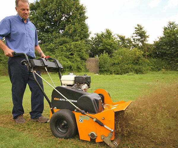 UK Lawn Care Association technician scarifying a lawn